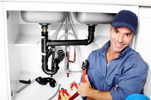 Contractor Working On A Broken Leaking Pipe And Fixtures In A Plumbing Emergency