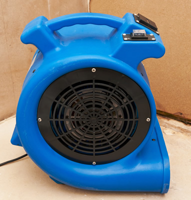 Turbo fan drying a water damaged floor